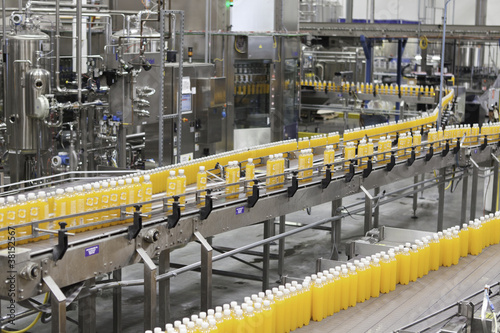 Juice bottles moving along the conveyor belt