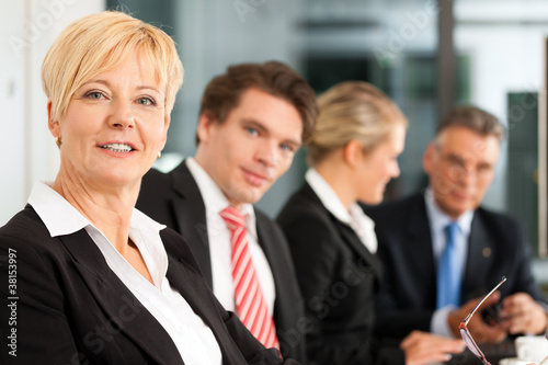 Business with female boss - team in office