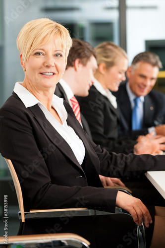 Business female boss - team in office