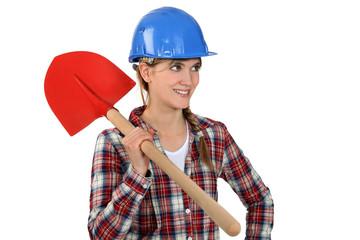 charming craftswoman holding a shovel