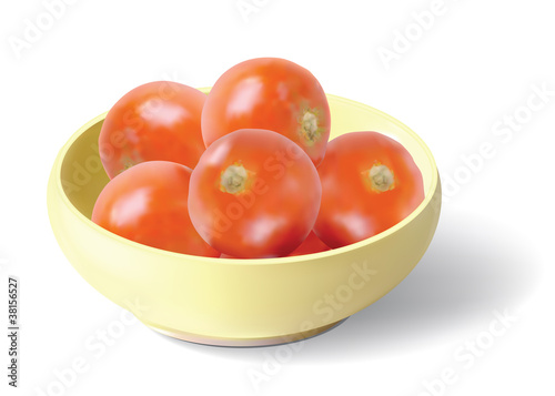 Tomatoes in yellow ceramic bowl.
