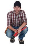 crouching plumber
