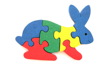 Colorful wooden rabbit puzzle toy on white background