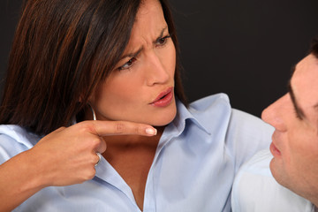 Woman blaming her husband