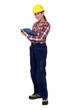 Tradeswoman holding a clipboard