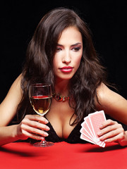 pretty woman gambling on red table