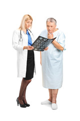 Senior man with his doctor, looking at the results of his CT sca