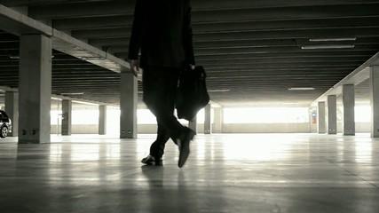 Businessman in underground parking; Full hd photo JPEG
