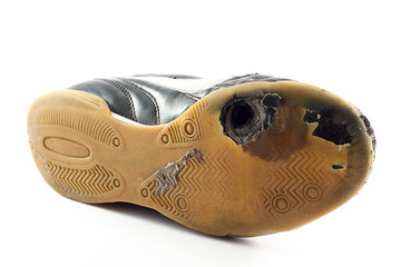 Worn out Sports Shoe with hole