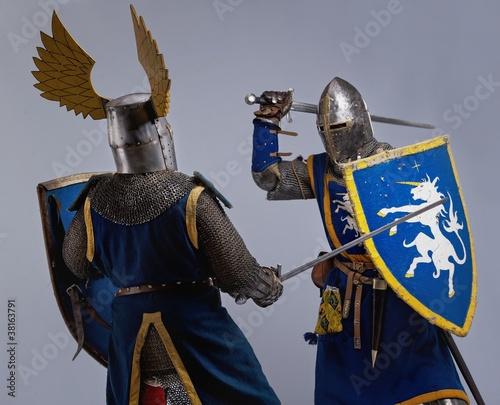 Staande foto Two medieval knights fighting.