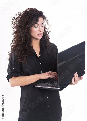 Pretty woman working on her laptop