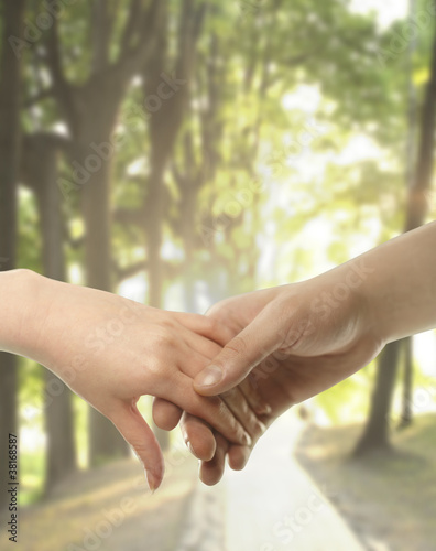 Couple hands closed together outdoors