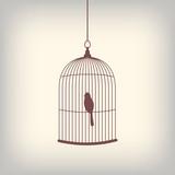 Fototapety Vintage bird cage with single bird inside.