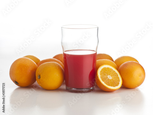 orange juice with oranges on white background