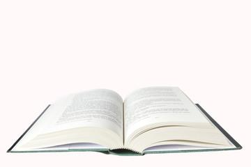 Libro aperto su fondo bianco