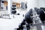 Fototapety Fitness club weight training equipment gym