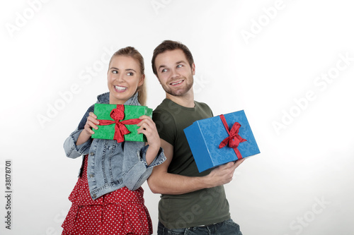 A happy couple give each other gifts