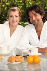 Couple having breakfast in their garden