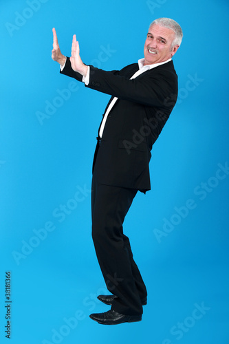Man straining to push a heavy object