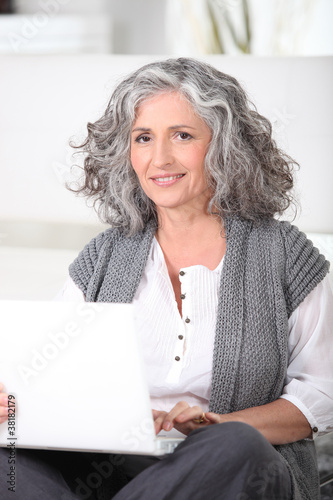 Middle-aged woman with laptop