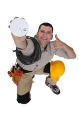 Electrician with a smoke alarm