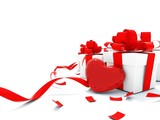 Presents with heart and ribbons isolated on white