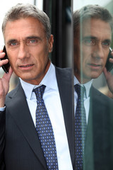 senior business man at phone