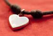 pendentif en forme de coeur argenté