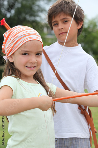 Children with bow and arrow
