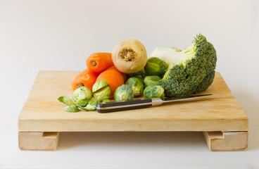 fresh garden vegetables on chopping board
