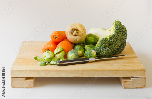 fresh garden vegetables on chopping board