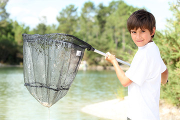 Young boy with a large fishing net