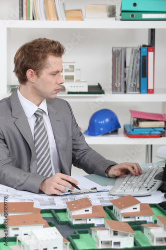 Young architect sitting at his desk