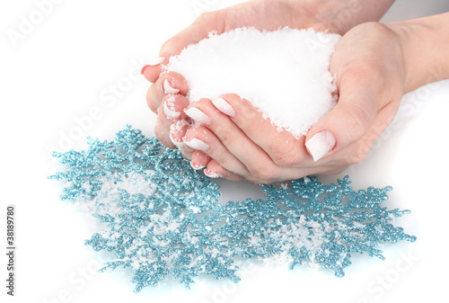 hands with snow and snowflakes isolated on white