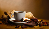 Fototapety coffee cup and beans, cinnamon sticks, nuts and chocolate