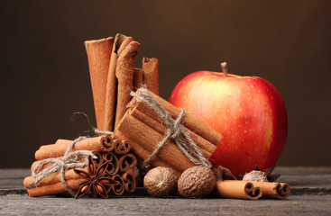 Cinnamon sticks,red apple, nutmeg,and anise