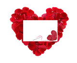 beautiful heart of red rose petals and greeting card with textil