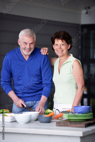 Elderly couple preparing a meal
