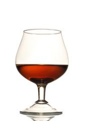 Glass of cognac isolated on white