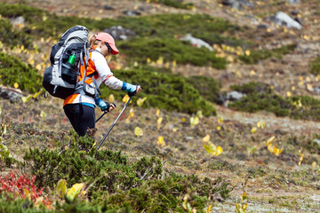 Woman backpacker hiking in mountains