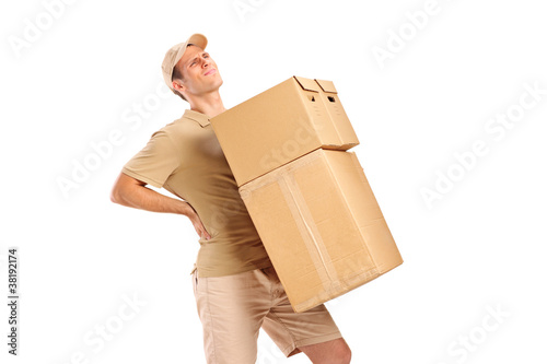 A delivery boy suffering from back pain while carrying boxes