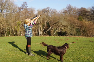 Girl with rifle and her Gun Dog