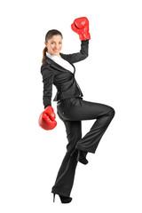 Beautiful business woman wearing boxing gloves