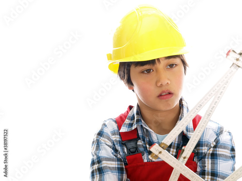 boy wearing construction helmet