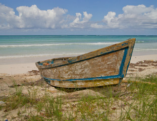 Old wooden boat on Jamaican beach