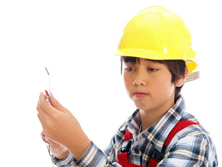 boy wearing construction helmet