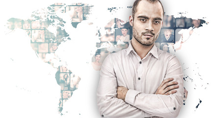 A handsome business man against world map on background with man