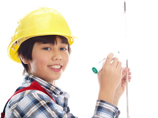 smiling boy wearing construction helmet