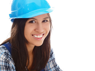 smiling girl wearing blue overall and helmet
