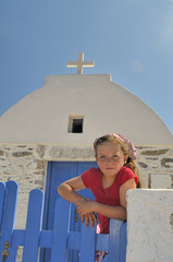girl in front of an Orthodox church - Greece